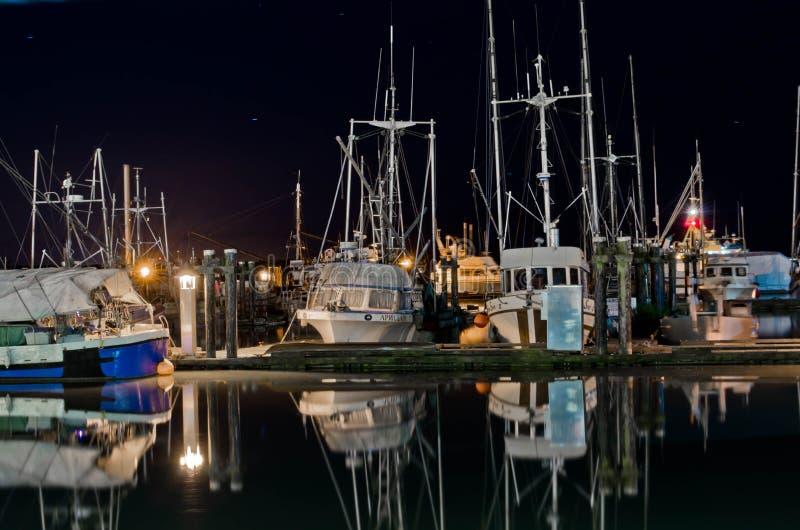 Boats at marina at night in Steveston, British Columbia stock photography