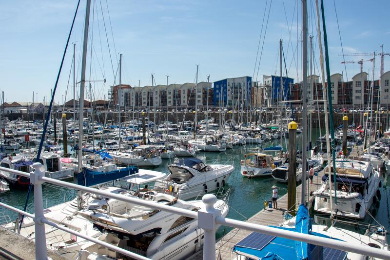 Boats in the marina at St Helier. St Helier, Jersey, United Kingdom, - 07, 24, 2019: view of the marina and harbor facilities royalty free stock photo
