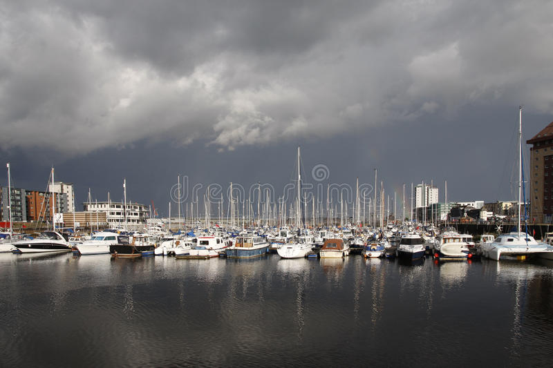 Boats in a marina with stormy sky stock photos