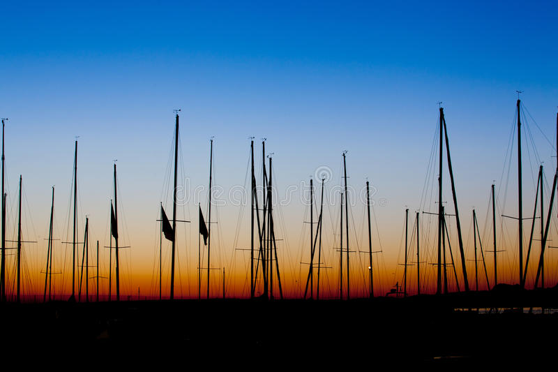 Boats Mast sillhoutte sunrise royalty free stock image