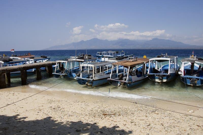 Boats at Menjangan island and view of Bali island. In Indonesia royalty free stock photos