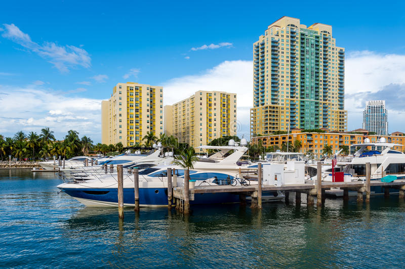 Boats in Miami Beach Marina. View of luxurious boats and yacht docked in a Miami Beach Marina stock photo