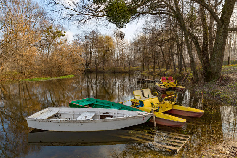 Boats on moorage. In autumn park stock image