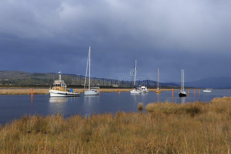 Boats moored at Franklin on Huon River Tasmania stock photography