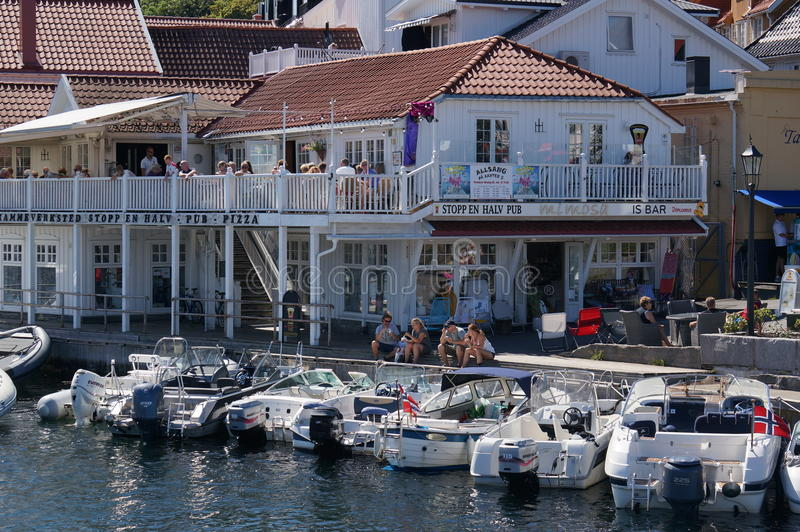 Boats moored in front of a restaurant, Norway stock photo
