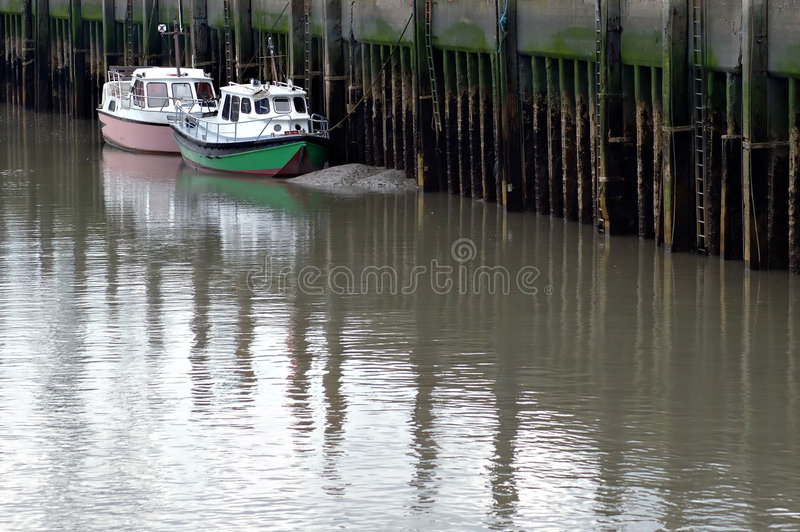 Download Boats Moored By Harbor Jetty Stock Photo - Image: 693572