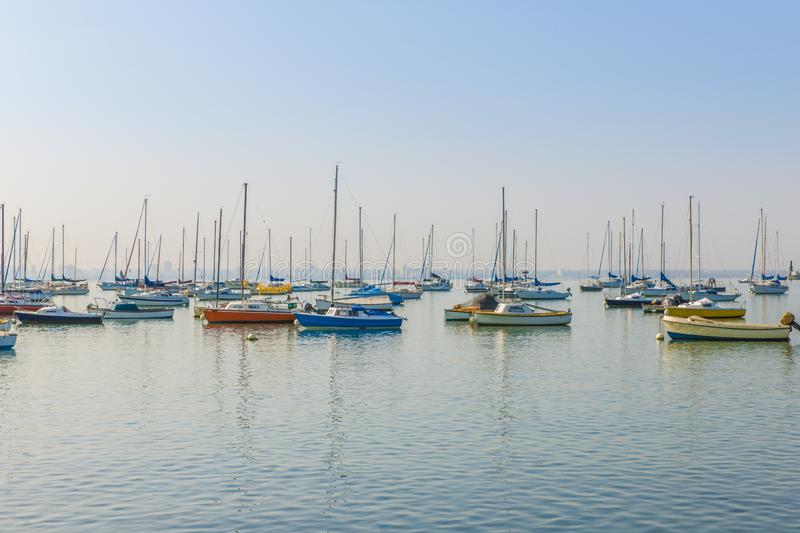 Boats moored in peaceful harbor. Boats moored in calm harbour early morning or late afternoon royalty free stock photos