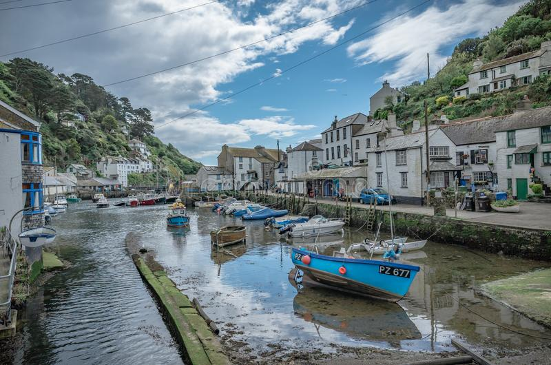 Polperro harbour on the south coast of Cornwall. Boats moored in Polperro harbour on the south coast of Cornwall on a sunny day royalty free stock photography