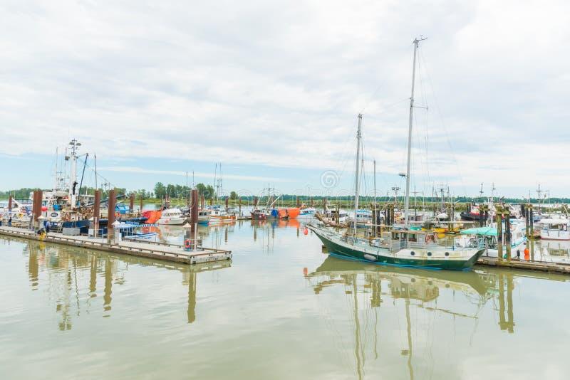 Boats moored at Steveston Village in Richmond, British Columbia, Canada. Richmond, British Columbia/Canada - June, 24, 2018: various boats moored at the marina stock photos
