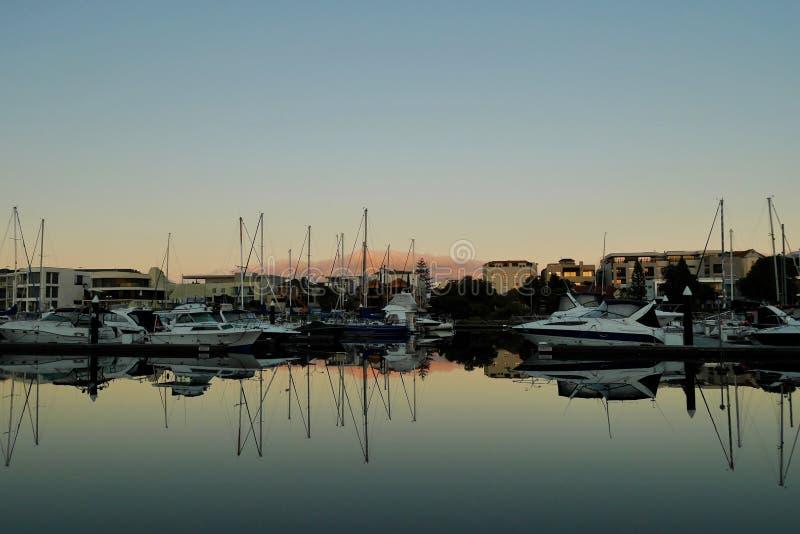 Boats moored at sunrise stock photos