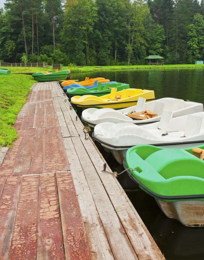 Boats moored to the shore royalty free stock images