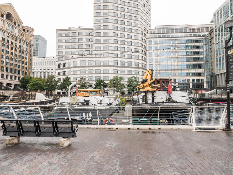 Boats at mooring at West India Quay, Docklands, London. London, England, August 25, 2015: Boats at mooring at West India Quay, North Dock, Docklands royalty free stock photography
