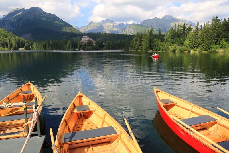 Boats on moorage. Boats on mountain lake moorage, Strebske Pleso. Slovakia royalty free stock photo