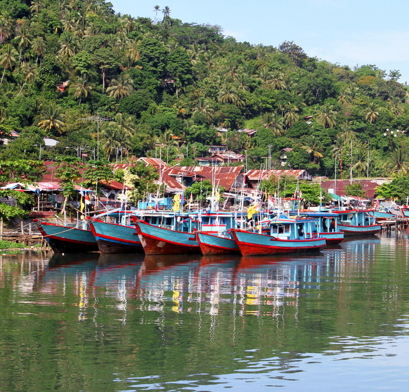 Boats on the Batang Arau River in Padang, West Sumatra. Fishing boats along the Batang Arau river in Padang City in West Sumatra, Indonesia stock image