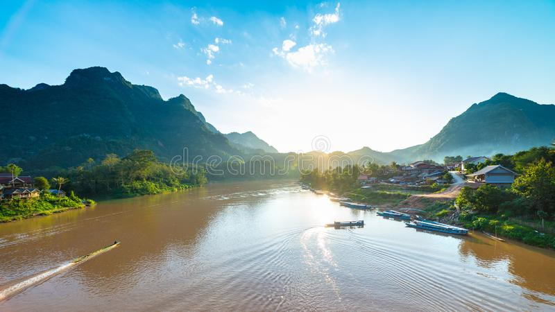 Boats on Nam Ou River at Nong Khiaw villlage Laos sunset clear sky dramatic landscape famous travel destination backpacker in. South East Asia stock photography
