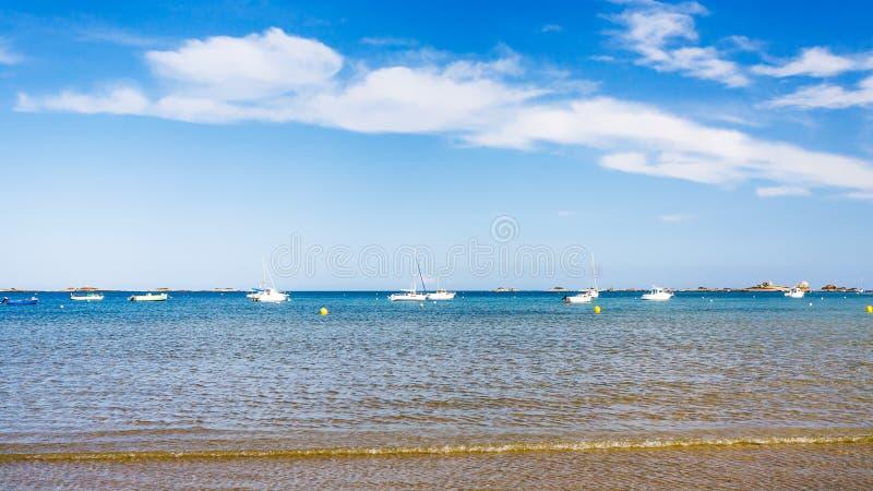 Boats near beach Plage de la Baie de Launay. Travel to France - boats near beach Plage de la Baie de Launay on bay Anse de Launay of English Channel in Paimpol stock photos