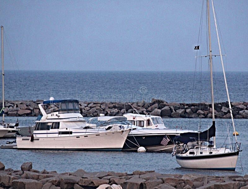 Boats near Breakers royalty free stock photography