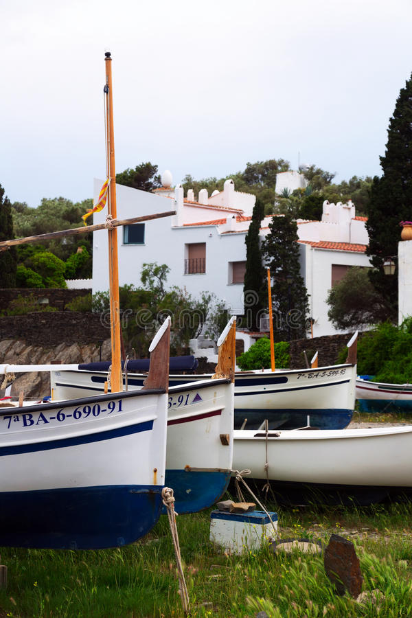 Boats near home of Dali at village of Port Lligat. Cadaques. CADAQUES, SPAIN - MAY 14, 2015: Boats near home of Dali at village of Port Lligat. Cadaques royalty free stock images