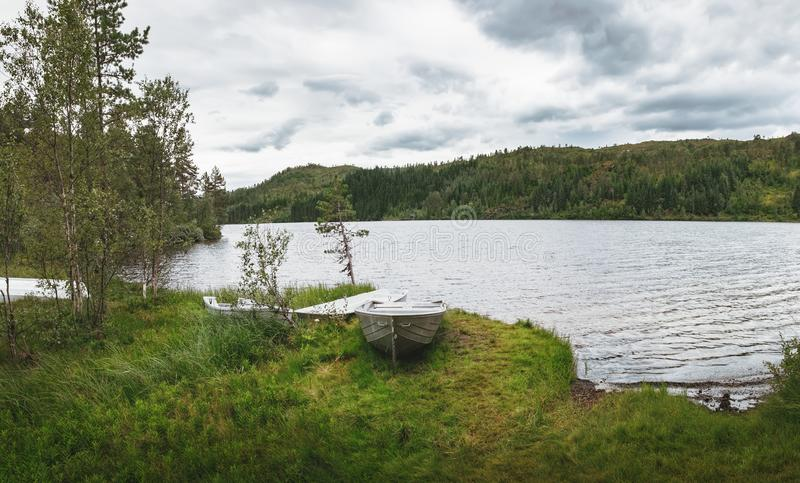 Boats near the Langelandsvatnet lake in Norway stock images