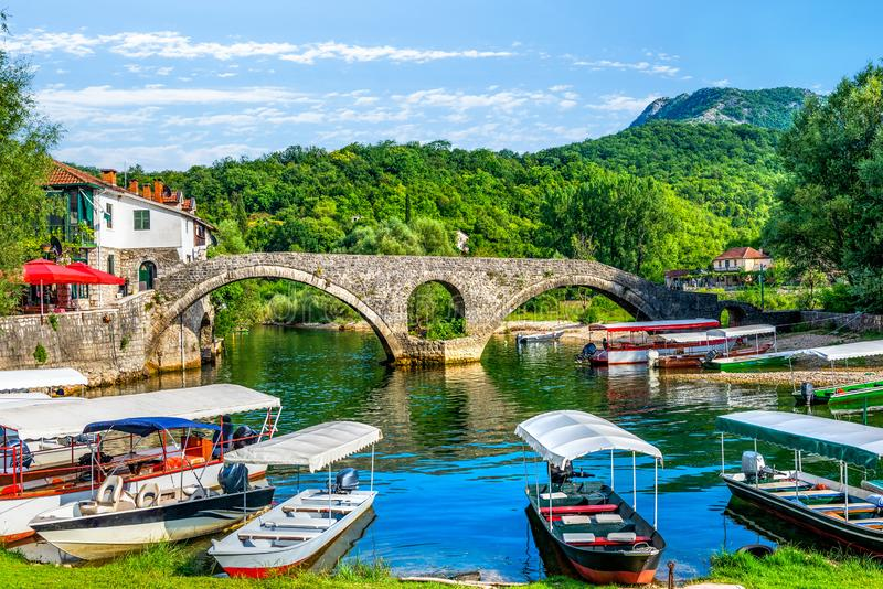 Boats near Stari Most. On Crnojevica river in Montenegro royalty free stock photos