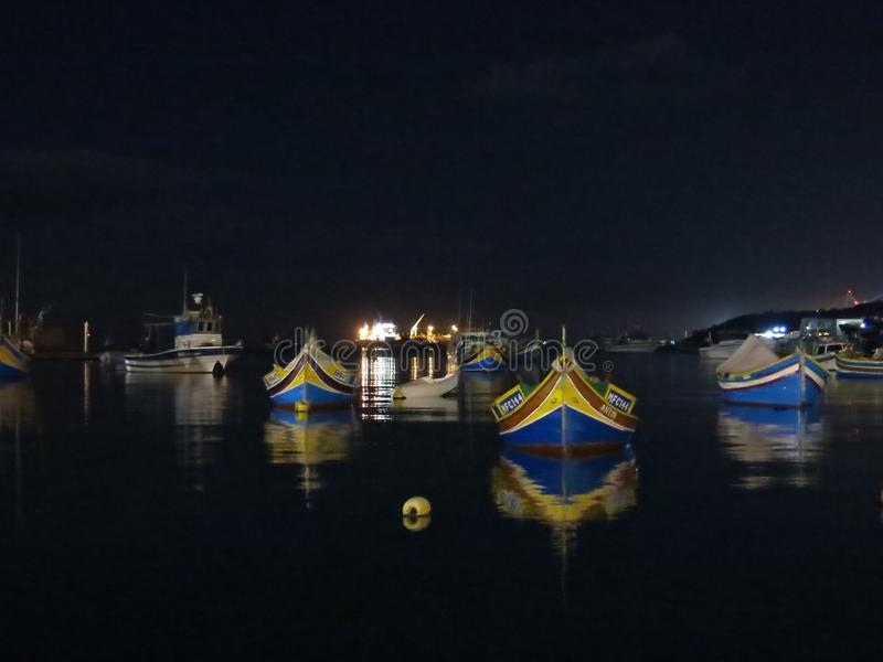 Boats at night, Marsaxlokk, Malta royalty free stock image