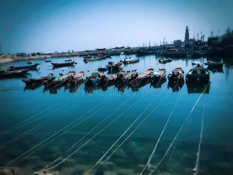 Boats in the ocean in Dalian city stock photo