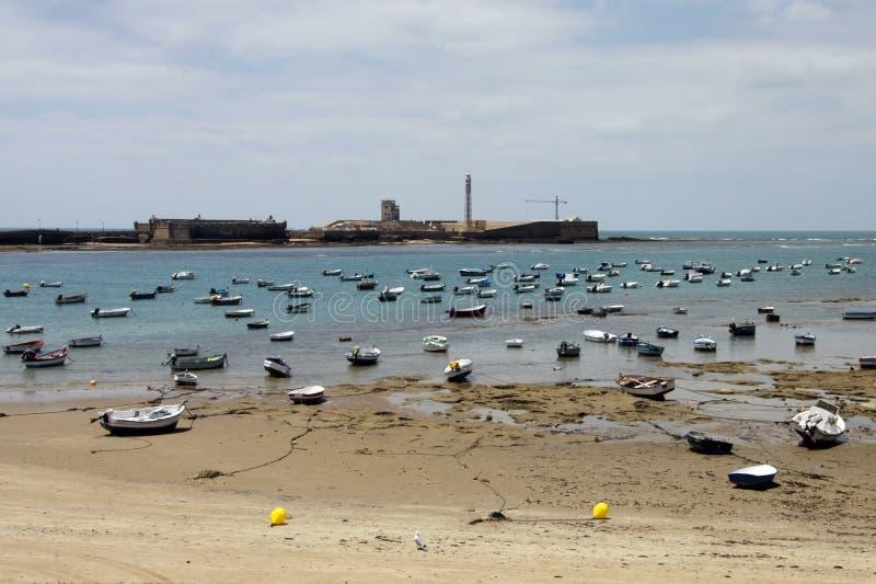 Boats off the Atlantic coast near the fortress of San Sebastian in Cadiz. stock photography