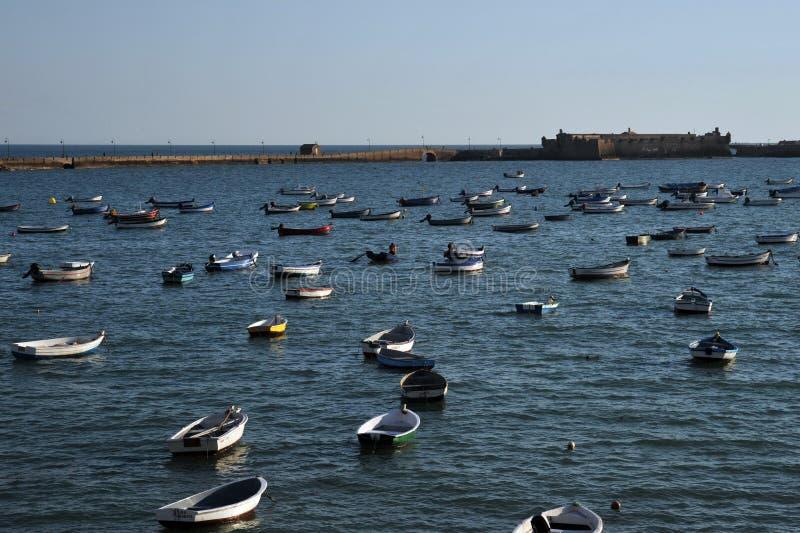 Boats off the Atlantic coast near the fortress of San Sebastian in Cadiz. royalty free stock photos