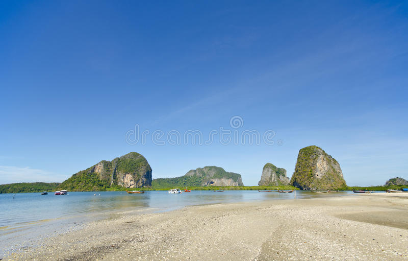 Boats at Pak Meng Pier, Trang Province, Thailand. Boats Under Blue Sky at Pak Meng Pier, Trang Province, Thailand royalty free stock images