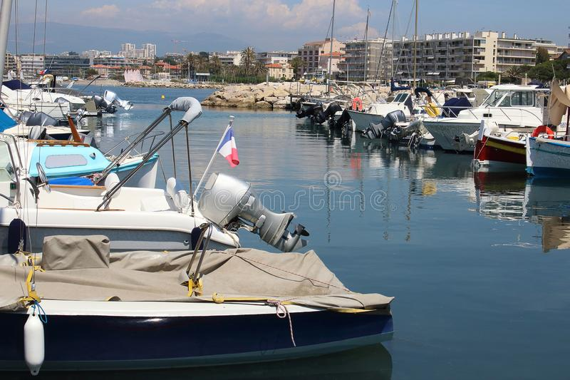 Boats parked in dock on blue water. And cityscape background, summer, travel, landscape, ocean, sea, coast, outdoor, vacation, nature, beautiful, shore stock photography