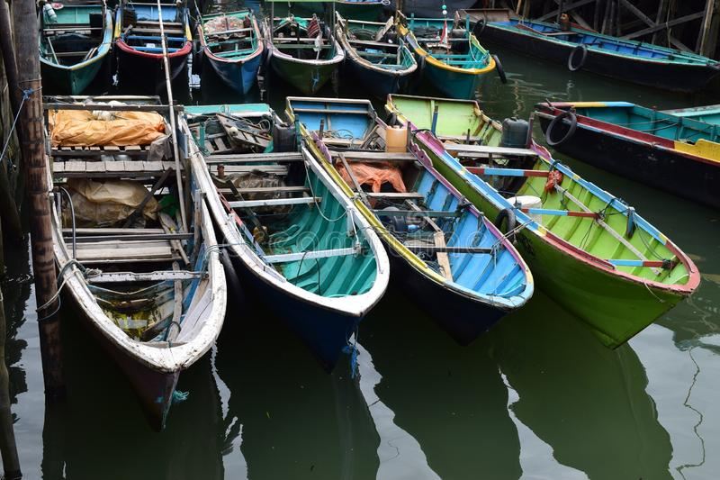 Boats in parked in a pier beach royalty free stock images