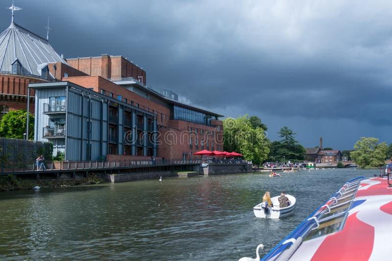 Boats passing in front of the Royal Shakespeare Theatre stock images