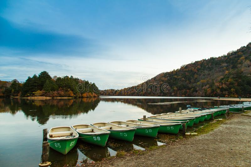Boats at the pier of the Nikko park at autumn. Japan stock image