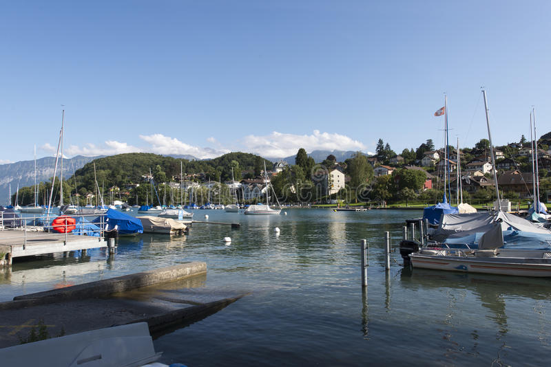 Boats at the pier of Spiez, Switzerland stock photos