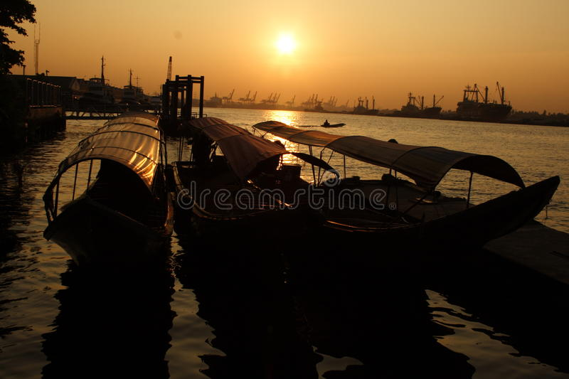 The boats are in the pire, at the sun set. Bangkok Thailand royalty free stock photography