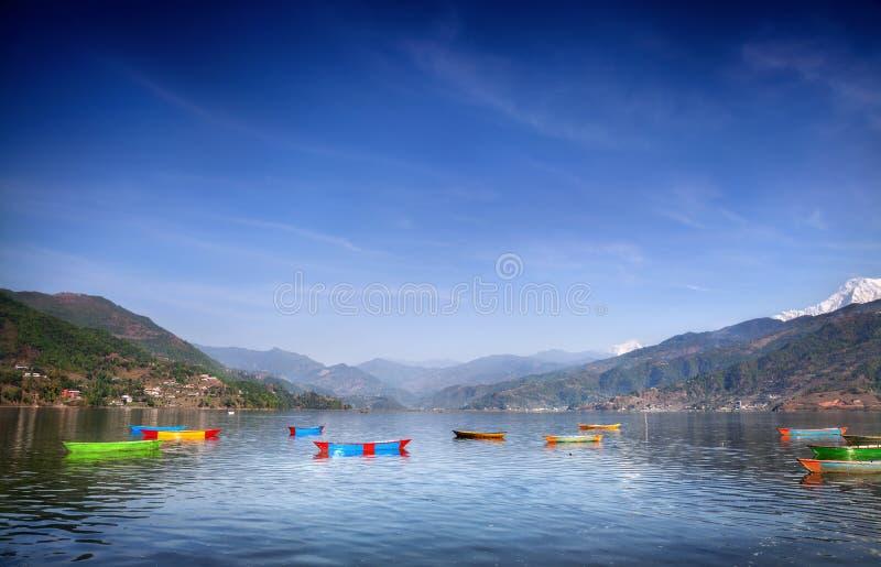 Boats in Pokhara lake stock photography