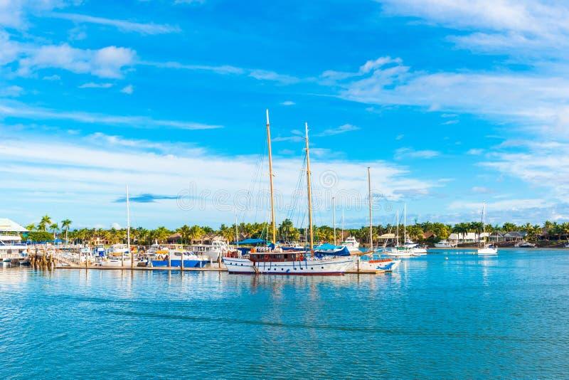 Boats in the port of Denarau, Nadi - Fiji. Copy space for text.  royalty free stock photos