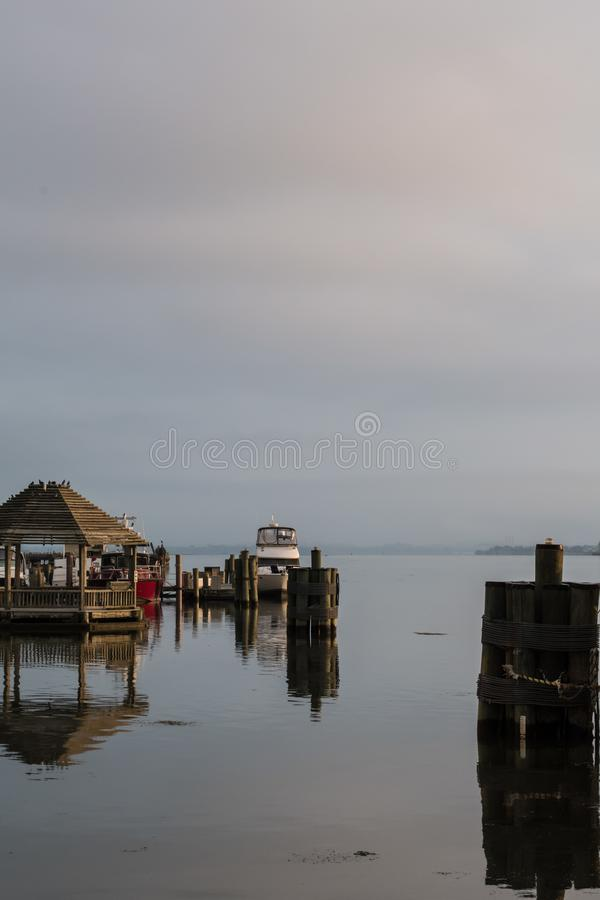 Misty Morning sunrise on the Potomac - Boats rest in the harbor royalty free stock image
