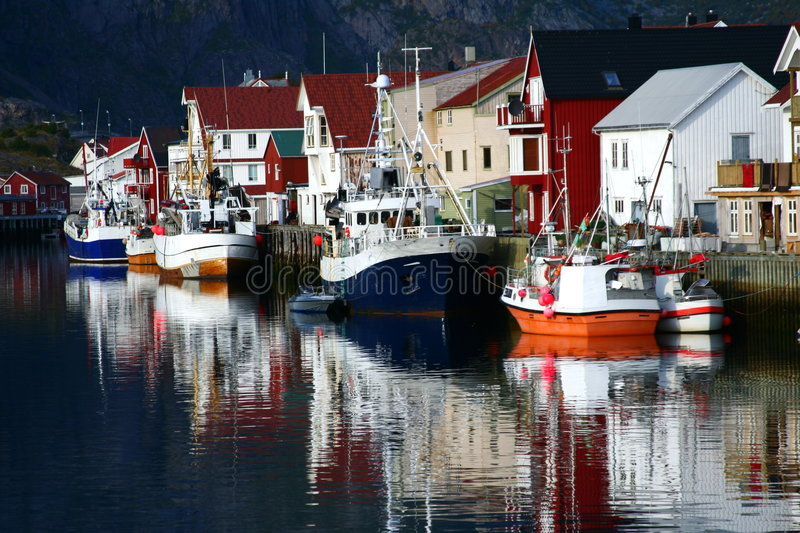 Boats reflecting in the sea royalty free stock photography