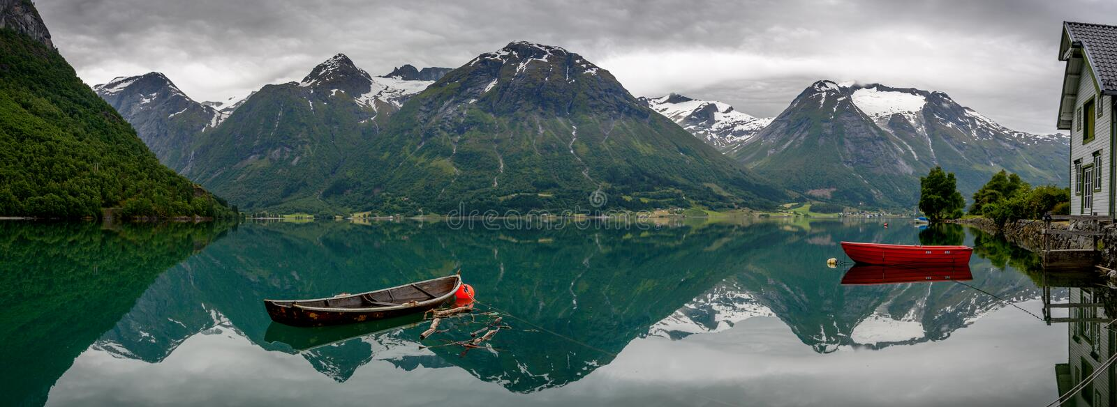 Boats and reflection in the water in panorama stock photography