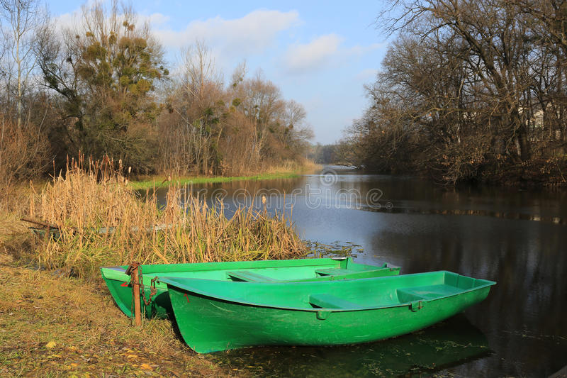 Boats on river moorage. Two boats on river moorage in park royalty free stock images