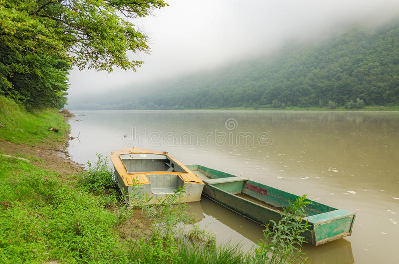 Boats on the river. National Park Dnister Canyon, Ukraine. Fog over the river stock photo