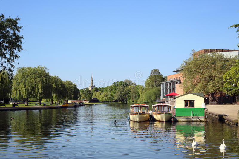 Boats on the River at Stratford-upon-Avon. Boats on the River Avon at Stratford-upon-Avon. With the Royal Shakespeare Theatre in the background royalty free stock photography