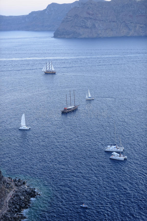 Boats sailing in Aegean sea royalty free stock photography