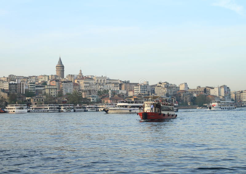 Boats sailing Golden Horn Bay in Istanbul stock photos