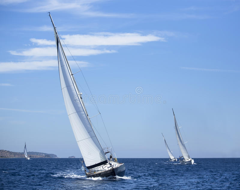 Boats in sailing regatta. Luxury yachts. royalty free stock images