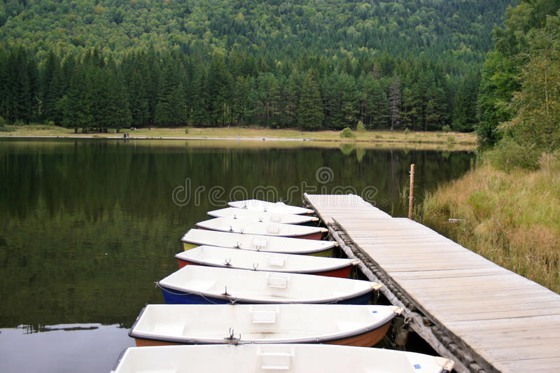 Boats on the saint ana volcanic lake, romania stock image