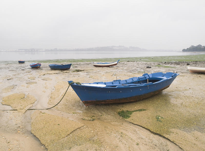 Download Boats In The Sand On A Cloudy Day Stock Photo - Image: 25481648
