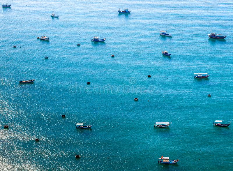 Small and large boats in the sea stock image