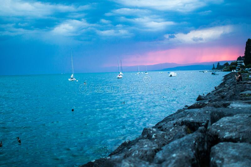 Boats on the sea at sunset stock photography